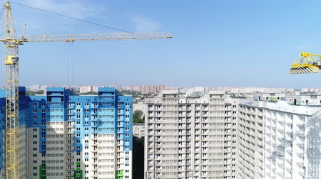 aerialphotography : Aerial view - construction and building crane. City and buildings.