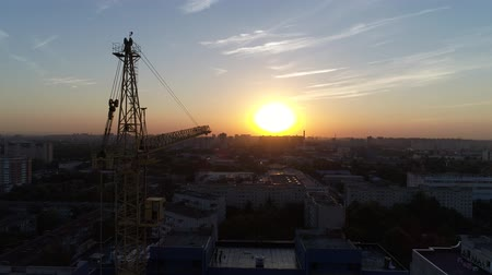 aerialphotography : Aerial view: construction crane on sunset background.