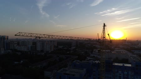 aerialphotography : Building crane on the background of sunset or dawn.