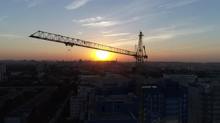 aerialphotography : Aerial view: Building crane on the background of sunset or dawn.