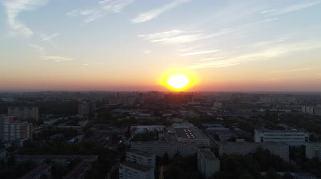 aerialphotography : Aerial view: city on a sunset background. Buildings, streets and sunset. Stock Footage