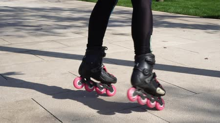 inline skating : Woman rotates on roller skates, slow motion.