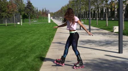inline skating : Beautiful woman on roller skates.