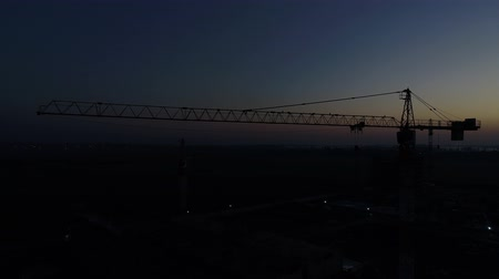 aerialphotography : Dawn, twilight, silhouette of a construction crane. Stock Footage