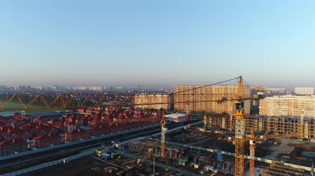 aerialphotography : Construction cranes and city buildings.