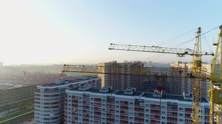 aerialphotography : Construction cranes on the background of buildings.