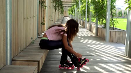 inline skating : Beautiful young woman with roller skates.