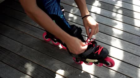 roller blading : Woman and roller skates, close-up.