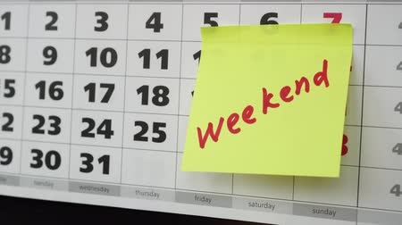 planlamacı : Office calendar, stickers and inscription Weekend.