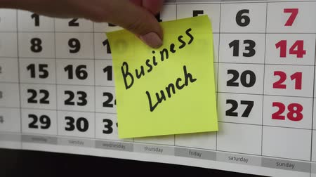 planlamacı : Business lunch, calendar and sticker. Stok Video
