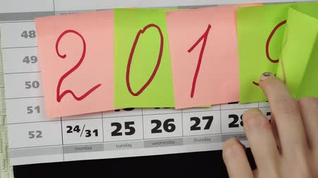 organizatör : Colored stickers with numbers 2019 on the calendar. Concept of the New Year 2019.