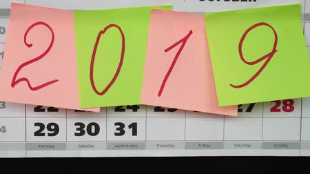 měsíčně : Idea of the New Year 2019. Calendar and colored stickers with numbers 2019.