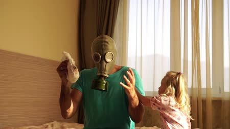 unpleasant smell : A man in a gas mask with a dirty diaper.