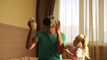 отцовство : father of a respirator changes the babys dirty diaper.