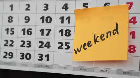 memo : The concept of the weekend, office calendar, weekend inscription on the sticker.