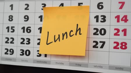 planlamacı : Office calendar, sticker with the inscription lunch. Stok Video