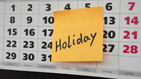 planlamacı : Office calendar, sticker with the inscription holiday.