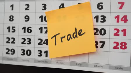memo : Office calendar, sticker with the inscription trade. Stock Footage