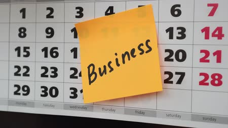 planlamacı : Business concept, office calendar, sticker with the inscription business.