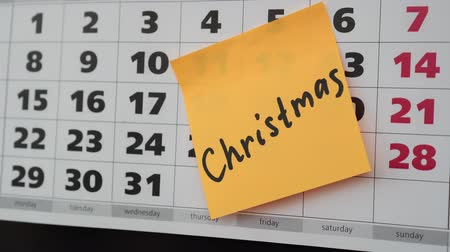 planlamacı : Concept of Christmas. Office calendar, sticker with the inscription Christmas. Stok Video