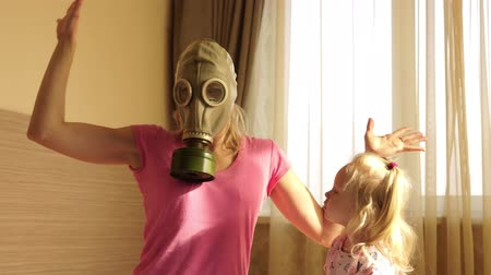 unpleasant smell : A woman in a gas mask with disgust holds a dirty baby diaper.