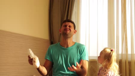 unpleasant smell : Unhappy young father changes dirty baby diaper. Stock Footage