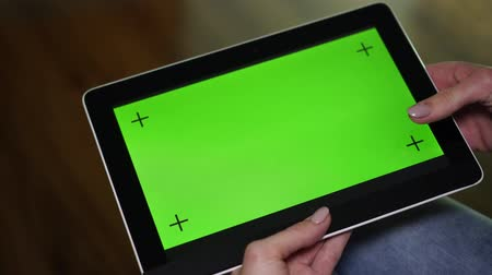 ped : Tablet with green screen, close-up.