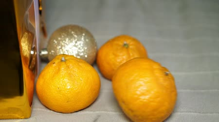 composição : Fresh tangerine rolling in slow motion. Christmas and New year concept. Stock Footage