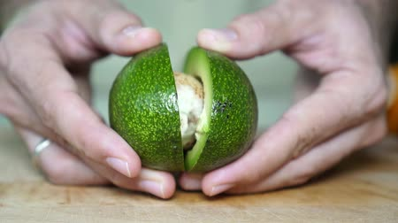 vejetaryen : Close-up, ripe green avocado in the kitchen. Stok Video
