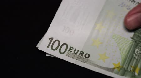 összeg : Euro banknotes close-up. Euro money on a black background. Stock mozgókép