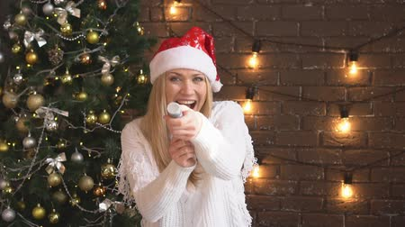 szenteste : Christmas, young woman with a firecracker and confetti.