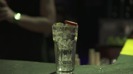 barman : bartender makes a cocktail with ice, slow motion.
