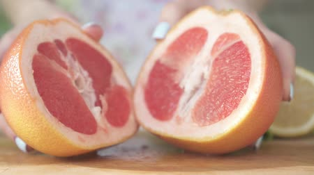 antioxidant : A woman and a beautiful grapefruit in the kitchen.