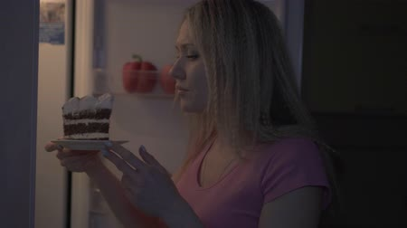 Diet, willpower, woman refuses to eat cake at night.