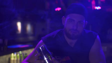 A brutal bartender in a nightclub.