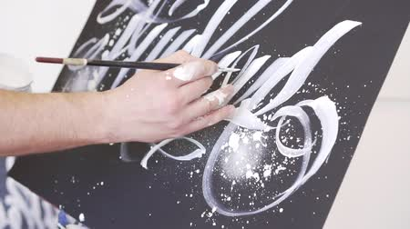 화필 : Slow motion, modern artist draws a picture, close-up.