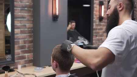 Barber man blow-dry client hair.
