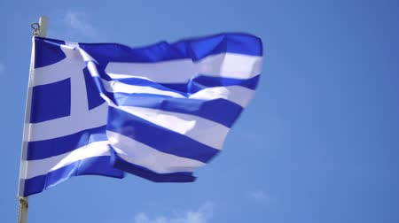 greece flag : flag of Greece on the flagpole sways in the wind against the blue sky. Stock Footage