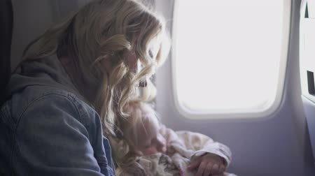 aircraft cabin : Woman and child in a flying airplane.