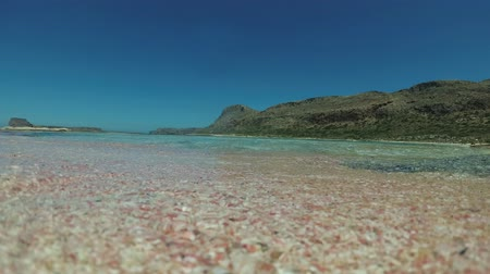waterline : Tropical beach, clear sea, pink sand, underwater action camera.