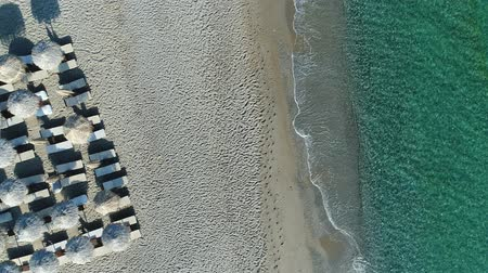 grece : Beautiful sea coast, tropical umbrellas and sandy beach, aerial view.