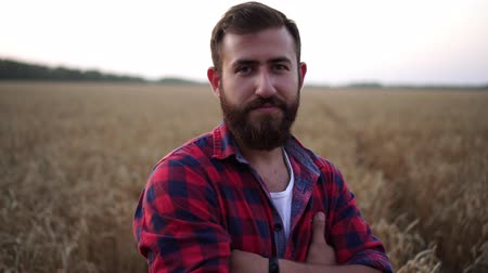 agronomia : Portrait of a modern male farmer on the background of wheat.