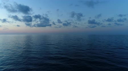 serene : Aerial panorama - calm sea in the evening. Dark sea at sunset.