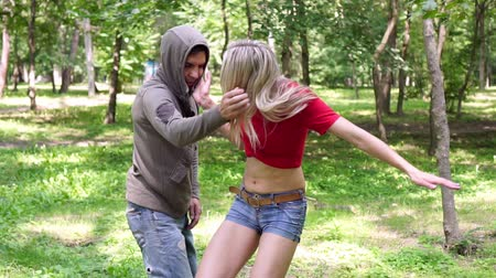 bully : A male criminal attacks a woman in a park, but gets a rebuff. Receptions of female self-defense.