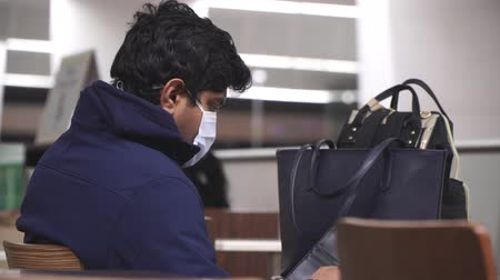 megelőzés : Delhi, India - March 2020. Indian man in medical mask at the airport.