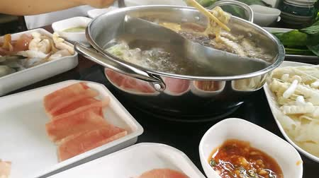 produced : Timelapes boiling in pot shabu sukiyaki japanese food style