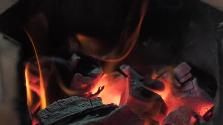 извержение : The orange flame in the charcoal stove.