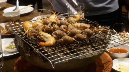 charcoal stove : Grilled Seafood on stove. Stock Footage