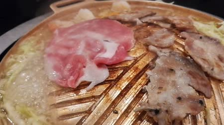 induction cooker : Grill pork , Close up of Meat grilled on brass pan.