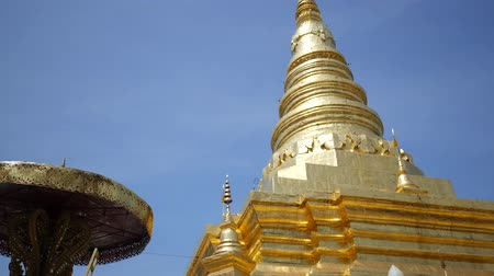 mianmar : Ancient golden pagoda traditional northern at Thailand, Wat Phra That Chae Haeng at Nan, Thailand Stock Footage